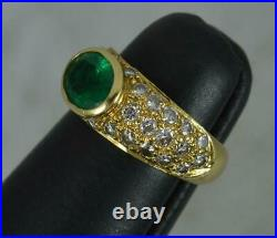 18 Carat Gold Emerald and 0.5ct Diamond Cluster Bombe Design Ring
