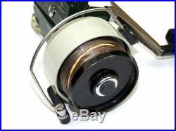 Abu Cardinal 77 Swedish spinning reel green and cream in fine condition