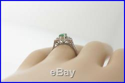 Antique 14k White Gold. 38ct Oval Emerald &. 06ct Round Diamond Scroll Ring