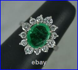 Classic 14ct White Gold Emerald and 0.9ct Diamond Cluster Ring