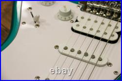 Fender Squier Affinity Stratocaster HSS Race Green fine crack in finish where