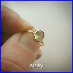 Fine 9ct solid Rose Gold ring with oval green peridot stone Vinader