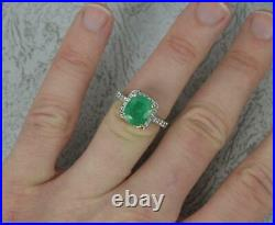Impressive 18ct White Gold Emerald and Vs Diamond Cluster Engagement Ring