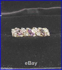NATURAL COLOR CHANGE BEKILY GARNETS. 41 TCW and DIAMONDS 14K GOLD RING BAND