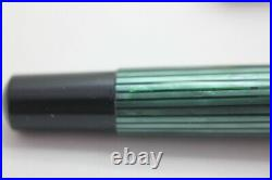 Old Style Pelikan M400 Green/Black excellent condition with 14K Fine Nib