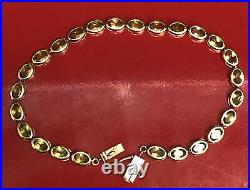 Solid 14K Yellow Gold/ Oval Light Green Gem Tennis Bracelet. 7.5 Inches
